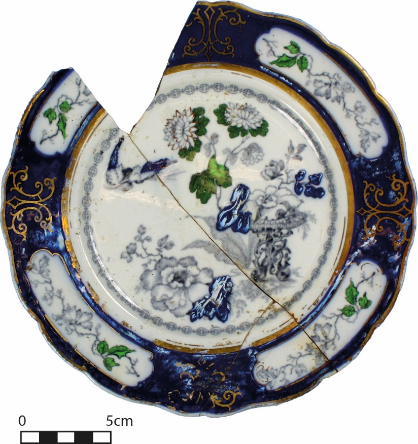 Transfer-printed and hand-painted plate. This objects history is closely tied with the chamber pot