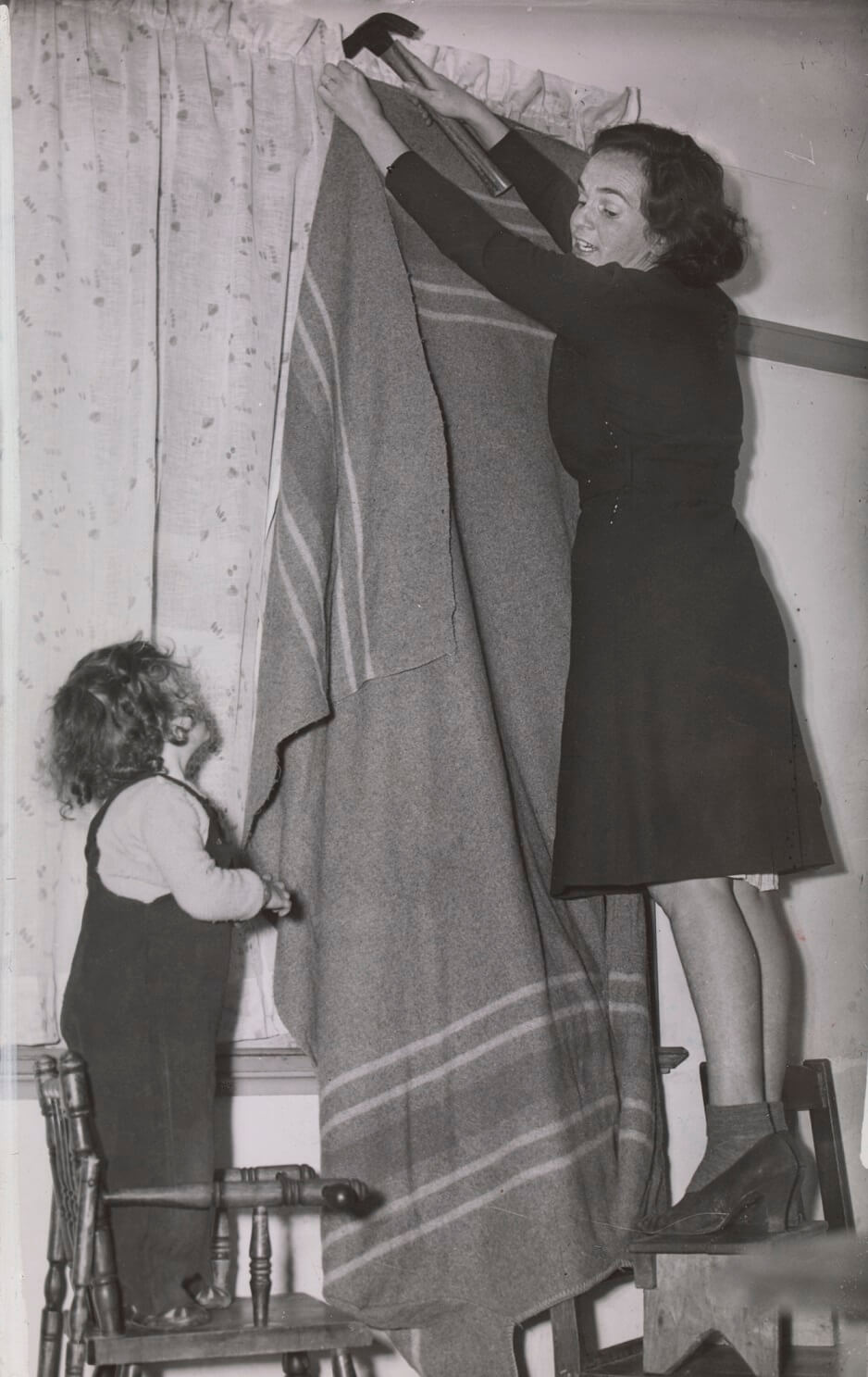 hammering up the black out curtain